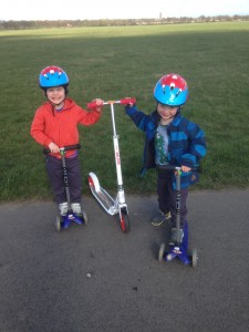 Adult Push Scooters Have Fun Keeping Up With The Kids