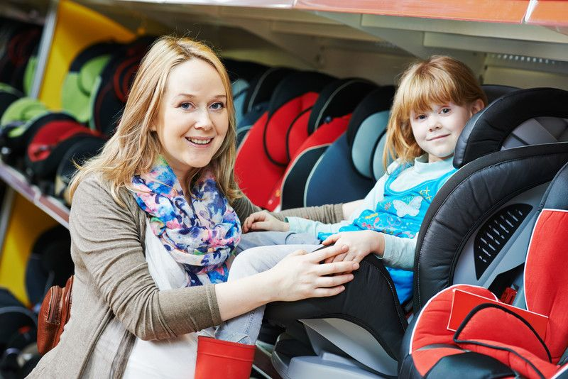 Mother and child choosing convertible car seat